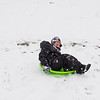 Joed Viera/Staff Photographer-<br /> Blake Marino, 7, takes a sled down a hill at Lockport Town and Country club.