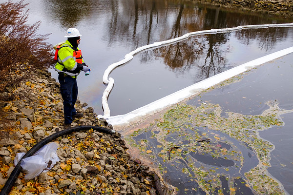 Joed Viera/Staff Photographer- A diesel leak in the Canal prompted a clean up under the Adams Street Bridge Wednesday Afternoon.
