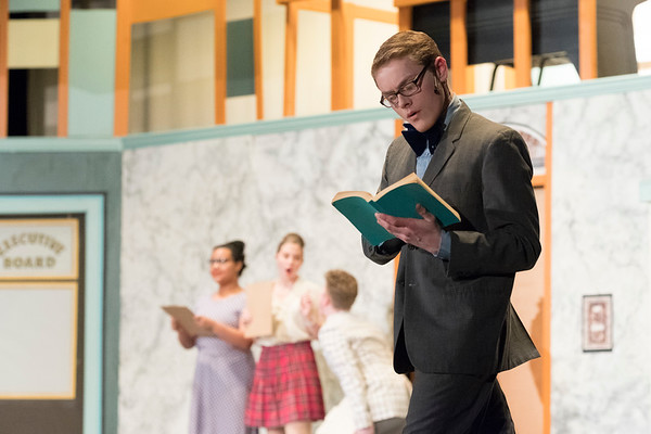 Joed Viera/Staff Photographer-Ben Flaherty performs as  J. Pierrepont Finch during Lockport High School's production of 'How to Succeed in Business Without Really Trying' Friday night.