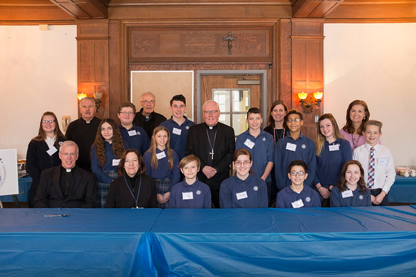 Joed Viera/Staff Photographer-Local preists joined Desales Catholic School students and staff for a group photo with Bishop Richard J. during his visit for Catholics School Week.