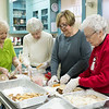 Joed Viera/Staff Photographer-Edna Stubbs, Sharon Strassel, Jill Driskel and Jean Haylett work in the Lockport United Church of Christ kitchen.