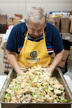 Joed Viera/Staff Photographer- <br /> John Ronaldo makes stuffing for the Salvation Army's Thanksgiving day feast at the Sister Mary Loretto Soup Kitchen Monday morning. Ronaldo is one of the founders of the yearly tradition.