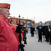 Joed Viera/Staff Photographer-Sid, a past commandant of the Lockport Devil Dogs play Taps to a cold Big Bridge crowd after a commemoration put on by the Navy Club in honor Pearl Harbor Day.