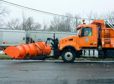 Joed Viera/Staff Photographer-Lockport ,NY-A Niagara County plow waits for a train to cross an icy Niagara Street.