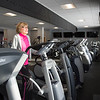 Joed Viera/Staff Photographer-Judy Brandt uses the treadmill at Ultimate Physique.