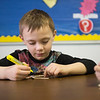 JOED VIERA/STAFF PHOTOGRAPHER-Steven Scott, 6, paints a popcicle stick dragonfly in the arts and crafts class during the YMCA's Easter Break Day Camp.
