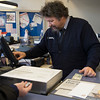 JOED VIERA/STAFF PHOTOGRAPHER-Lockport, NY-Bob Kubala rings up a  customer sorting through change while purchasing postage at the Lockport Post Office.