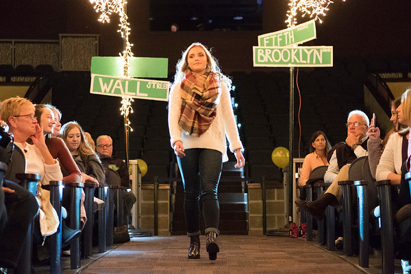Joed Viera/Staff Photographer- Kaylee Platter, 15, walks the runway at the annual DECA Club fashion show at the Lockport High School Auditorium Friday night. The 50 member club put on the show with a goal of raising $2,500 to use on expenses for different competitions.