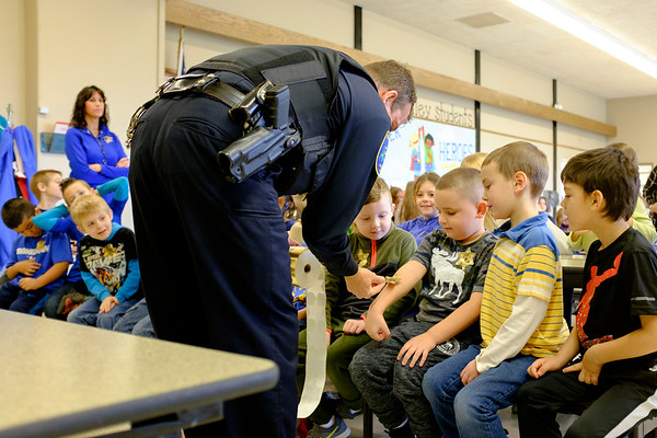 Joed Viera/Staff Photographer-  Niagara County Sheriffs Lt. Brian Harrer places stickers on Roy B Kelly students  after watching a video the students made in celebration of Lockport Blue.
