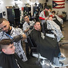 Joed Viera/Staff Photographer-Pagan's Barbershop seats are full of patrons just before closing Friday evening.