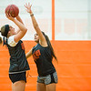 Joed Viera/Staff Photographer-Wilson seniors Shea Munnikhuysen and Morgan Faery play a one on one game during practice on Monday night.