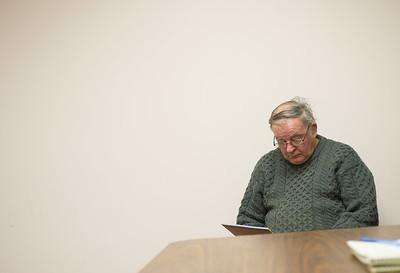 JOED VIERA/STAFF PHOTOGRAPHER-Lockport, NY-Patrick Feeley waits as absentee ballotts are counted  at the Niagara County Board of Elections. Thursday, November, 13 2014.