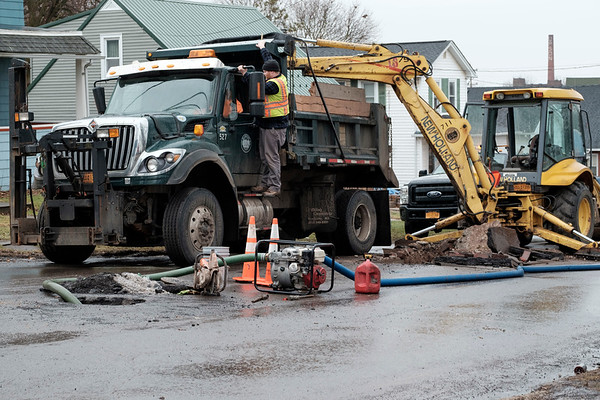 Joed Viera/Staff Photographer-A Department of Public Works crew works on High Street Friday afternoon.