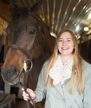 Joed Viera/Staff Photographer-Madeline Keyes with her quarterhorse Jackson.
