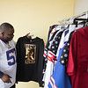 JOED VIERA/STAFF PHOTOGRAPHER-Lockport, NY-Big Willie Style and Fashion owner William Johnson sets up his new location at 38 Main Street.