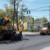 JOED VIERA/STAFF PHOTOGRAPHER-Lockport,NY-City crews work on patching up a section of East Avenue by Vine Street with blacktop Tuesday afternoon.