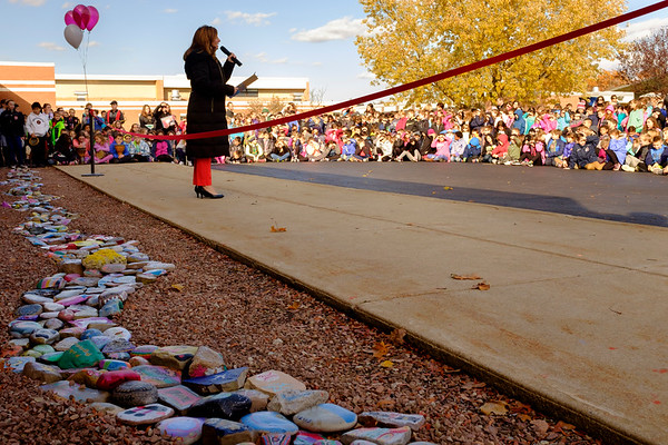 Joed Viera/Staff Photographer-Starpoint Regan Intermediate School Principal Monica Daigler speaks to students at a ribbon cutting ceremony for their Kindness Rocks display.