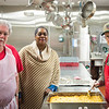 Joed Viera/Staff Photographer- Tom Newman, Rebia Maroney and John Harrington show off the  mac and cheese they served at the Salvation Army's Sister Mary Loretto Soup Kitchen Thursday afternoon.