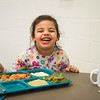 Joed Viera/Staff Photographer- <br /> Layla Saunders, 3, enjoys a plate of lasagna at the Sister Mary Loretto Soup Kitchen at the Salvation Army Monday morning.