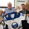 Joed Viera/Staff Photographer-Tenth Chance Animal Rescue founder Michelle Rott, Civil War historian Jim McGrath and Northwest Bank branch manager Greg Jasinski show off the Jack Eichel jersey at the Bank.