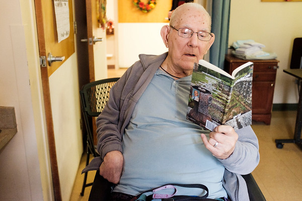 """JOED VIERA/STAFF PHOTOGRAPHER-Gasport, NY-Author John Cull reads from his latest publication """"Song of the Erie Canal"""" in his residence at Absolut Care of Gasport."""
