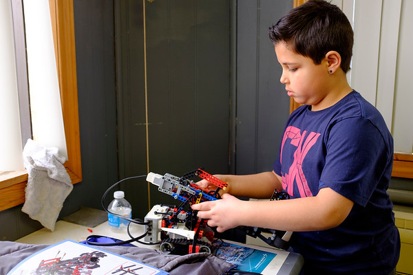Joed Viera/Staff Photographer-Ethan Cirillo, 10, builds a snatcher robot during a First LEGO League session at the Challenger Learning Center. The next five class session starts on April 10th at $7.50 per class or $25 for all five. To sign your child up call 716-434-3196 or email clclockportone@yahoo.com