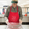 Joed Viera/Staff Photographer-John Harrington covers the mac and cheese he served at the Salvation Army's Sister Mary Loretto Soup Kitchen Thursday afternoon.