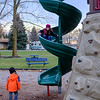 Joed Viera/Staff Photographer- Erik Caldwell, 4, watches as Maycle Bowes, 7, descends a slide at Day Road Park.