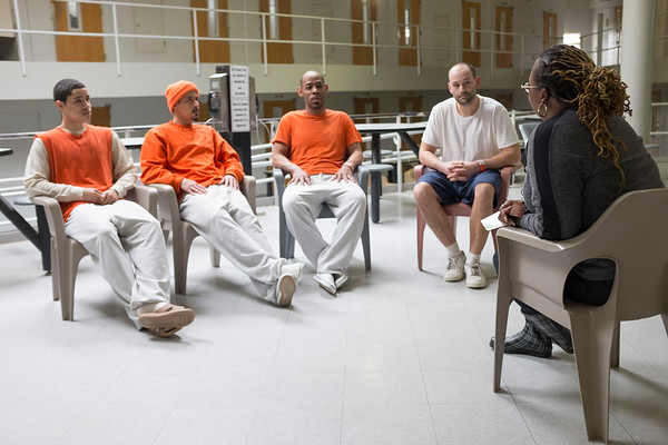 Joed Viera/Staff Photographer-Sterling Jones, Nikita Jones, Joshae Hudson and Jason Linderman discuss oppiod addiction with Best Self counselor Valarie Guthrie-Potts at NIagara County Correctional Facility.