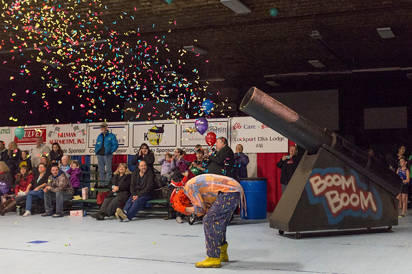 Joed Viera/Staff Photographer-Tweezer the clown ducks while Bugsy the clown gets shot out of a canon during the Exchange Club Circus Friday night at the Kenan Arena. The circus is a fundraiser for the Exchange Club, which supports over 25 community organizations. <br /> The show continues today at 1 and 4 p.m. Saturday. Tickets are $5 for adults and $3 for children. Volunteers will sell popcorn, soda and helium balloons for $1 each. At each intermission there is a raffle drawing for a new bicycle, sports tickets and other goodies.