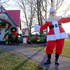Joed Viera/Staff Photographer-Santa Claus pays a visit to his Christmas Cottage at Day Road Park Saturday afternoon. The Cottage is open for visitors on Tuesdays and Thursday's from 5-8PM and on Saturday's from 12-3PM.