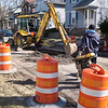 Joed Viera/Staff Photographer-City crews fill up a section of Oliver Street Monday afternoon.