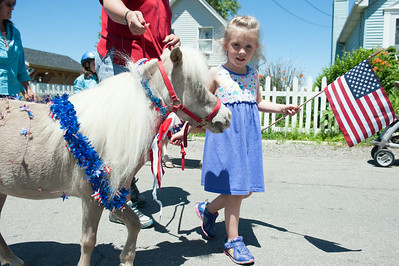 140704 JOED VIERA/STAFF PHOTOGRAPHER-Olcott, NY-Sophie LaPointe (4) walks noodle the pony during Olcott's Independance Day parade  on July 4, 2014.