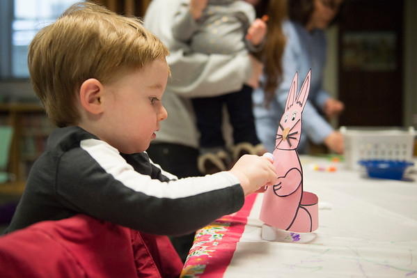 JOED VIERA/STAFF PHOTOGRAPHER-Lockport, NY- Noah Kennedy, 2, puts together an easter bunny hat during crafts at the Lockport Public Library.