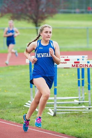 JOED VIERA/STAFF PHOTOGRAPHER-Medina NY-Newfane's Kimberly Goerss leads the pack during the girls 1600m event at Medina High School's track meet.
