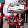 Joed Viera/Staff Photographer- Chris Parada and Lizzie Schratz hold up the trophys for the Ugly Sweater Race.