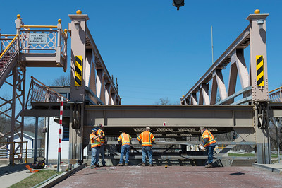 JOED VIERA/STAFF PHOTOGRAPHER-Lockport, NY-Canal Corporation workers perform maintenance on the Exchange Street Bridge.