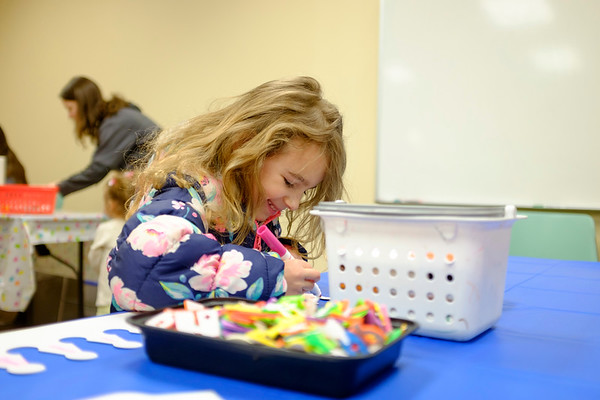 JOED VIERA/STAFF PHOTOGRAPHER- Adelynn Venesky, 5, colored crafts during the Lockport Public Library's 125th year anniversary kick-off event Thursday afternoon.
