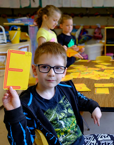 JOED VIERA/STAFF PHOTOGRAPHER-Lockport, NY-Universal Pre-K student Finnegan Tobin, 5, shows off the letter e during an assignment in Charlene Jones' all-day class at John E Pound Early Childhood Center..