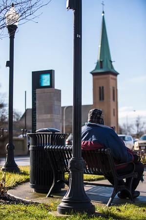 JOED VIERA/STAFF PHOTOGRAPHER-Lockport, NY-Darell Beason takes a seat on a Locks District bench along Canal Street