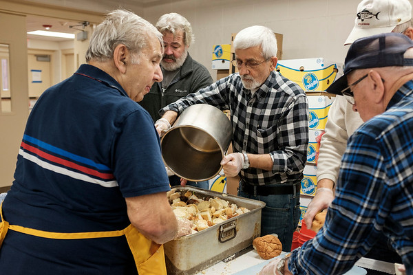 Joed Viera/Staff Photographer- <br /> John Ronaldo, Ron Cercone, Al Sammarco, Bob Fetterhoff, and Norm Pearson make stuffing for the Salvation Army's Thanksgiving day feast at the Sister Mary Loretto Soup Kitchen Monday morning.