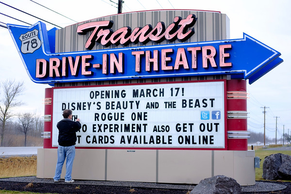 JOED VIERA/STAFF PHOTOGRAPHER-Lockport, NY-Owner Rick Cohen sets up the marquee at the Transit Drive-In Theatre. The Drive-In's season launches  on March 17th with Beauty and the Beast playing with Rogue One, and the Balko Experiment playing with Get Out.
