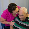 JOED VIERA/STAFF PHOTOGRAPHER-Lockport, NY-Cristal Nuñez kisses her father Roberto's head at Orchard Manor in Medina.