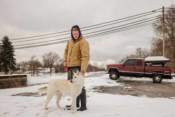 JOED VIERA/STAFF PHOTOGRAPHER-Gasport, NY-Jim Torriere walks his huskita Clyde  along the Canalway Trail in Gasport.