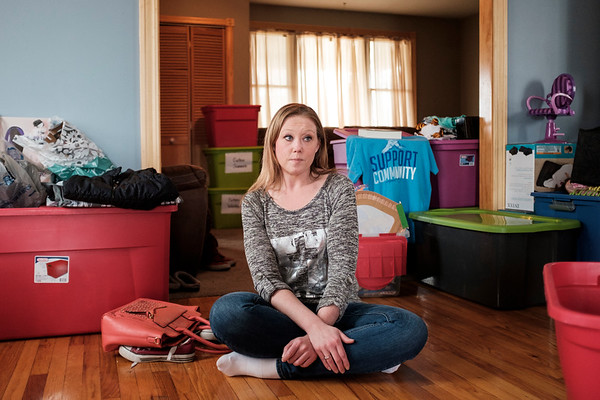 JOED VIERA/STAFF PHOTOGRAPHER-April Duleck sits in her friends home surrounded by buckets full of items donated to her family after a fire devestated her home last week.