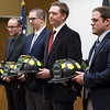 Joed Viera/Staff Photographer-Peter Burke, Nicholas Kazuba, John Messer and Corey Webster were sworn in as firefighters at City Hall Tuesday evening.