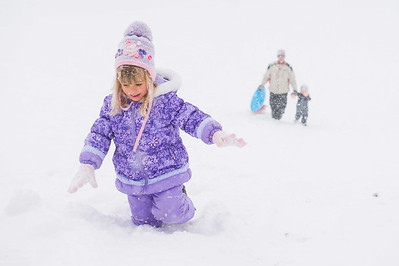 JOED VIERA/STAFF PHOTOGRAPHER-Lockport, NYConnie Case, 5, her father Ryan Case and brother Warren Case, 4, make their way up after  sledding down a hill at Lockport Town & Country Club.