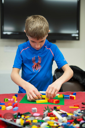 JOED VIERA/STAFF PHOTOGRAPHER-Jackson Schnackel, 8, takes part in LEGO Club at the Royalton Hartland Community Library Wednesday afternoon.