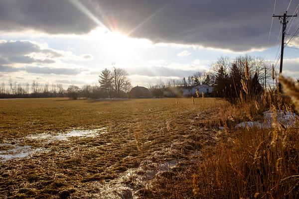 Joed Viera/Staff Photographer-A field floods on Mapleton Road.