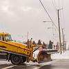 JOED VIERA/STAFF PHOTOGRAPHER-Lockport, NY-A DOT plow truck turns onto Transit Road.